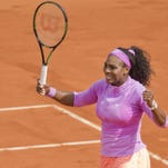 Serena Williams celebrates recording match point in her match against Sloane Stephens (on day nine of the French Open at Roland Garros.