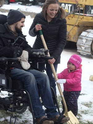Nyra Bargeron, 2, helps her parents, Lane and Emily, break ground on their new house in St. Johns in December.