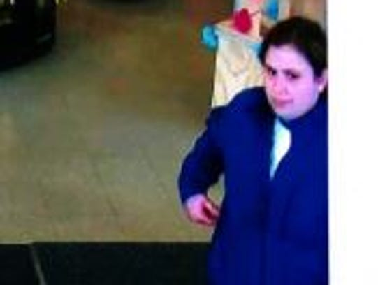 A suspect sought in the theft of an elderly woman's