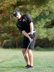 Windsor's Tim Buchek chips the ball on the first hole