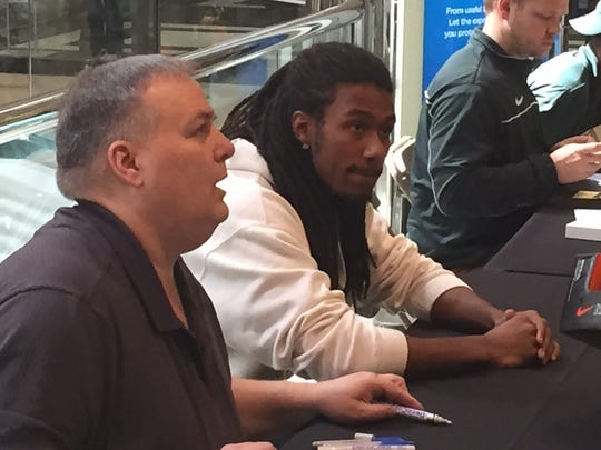 Michigan State cornerback Trae Waynes, second from left, signs autographs for fans at the Twelve Oaks' DC Sports shop in Novi on March 28, 2015.