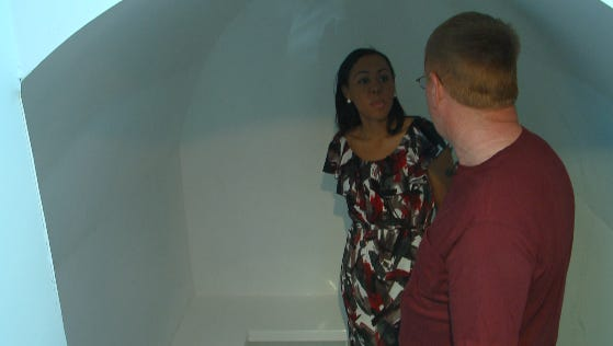 Macy Jenkins interviewing Mark Lemkelde about the storm shelter he installed.