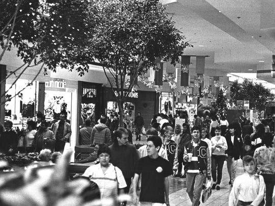 Shoppers navigate the corridor on Nov. 25, 1989 at Lakeview Square Mall.