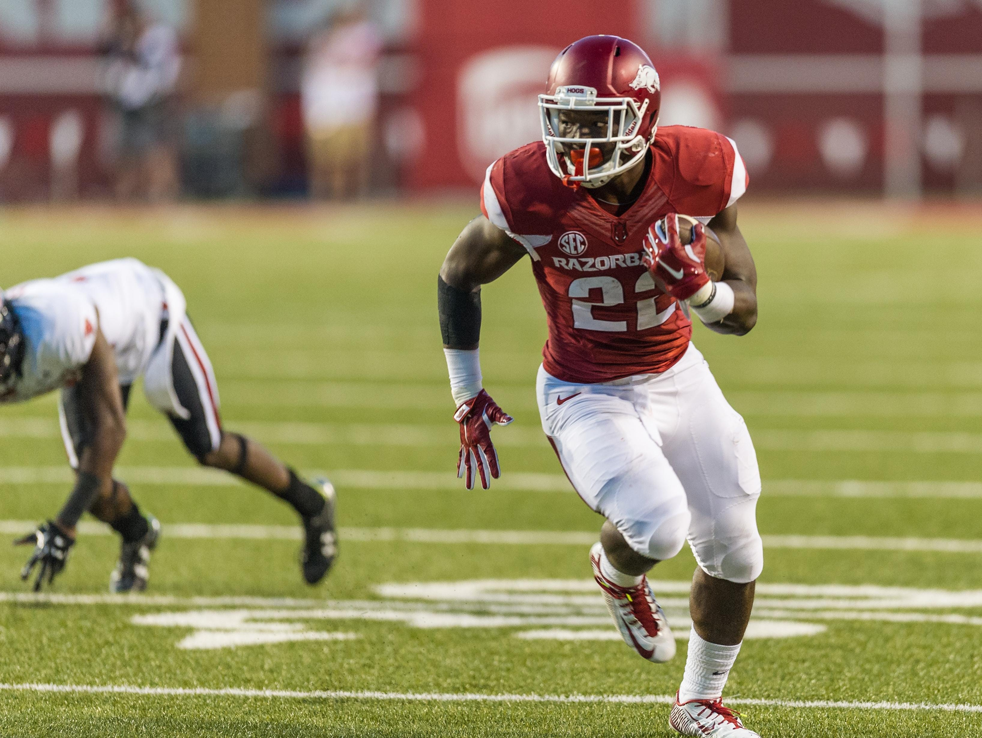 Arkansas running back Rawleigh Williams (22) carries during a game between the Razorbacks and the Texas Tech Red Raiders at Reynolds Razorback Stadium in Fayetteville.