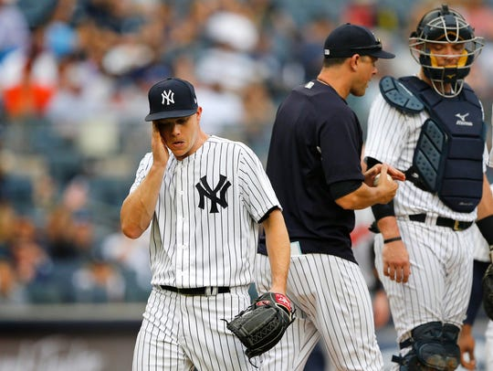 Yankees starting pitcher Sonny Gray (55) reacts after