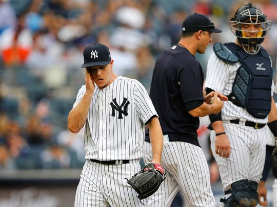 Yankees starting pitcher Sonny Gray (55) reacts after leaving the game in the third inning.