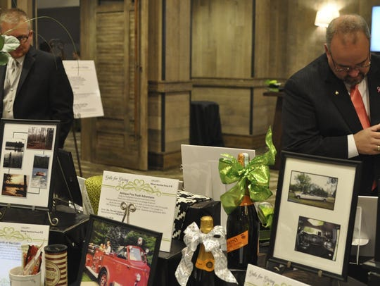 Silent auction items are displayed at the 2014 Gala