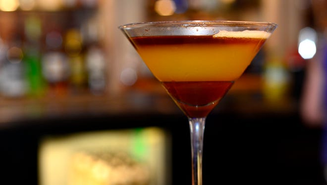 """The Vault is set for a soft opening on Friday at the former Happy Pig location at 200 S Alcaniz Street. The bar and restaurant will feature creative cocktails, like this layered martini called """"Sex with an Alligator,"""" and frequently changing menu focused on fresh and local foods."""