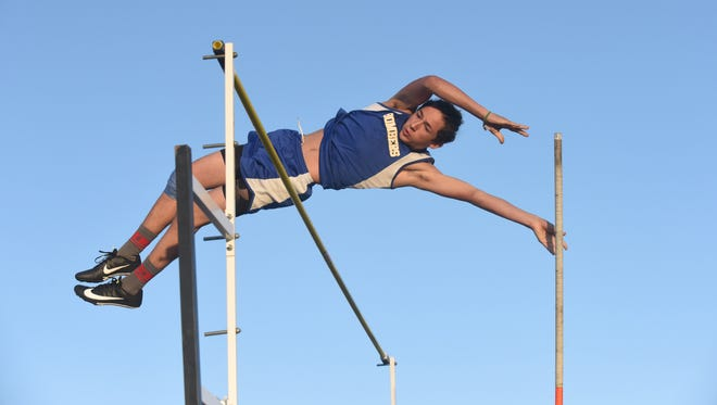 Mountain Home's Christian Sebree pole vaults a personal best 12 feet on Monday during the Bomber Relays.