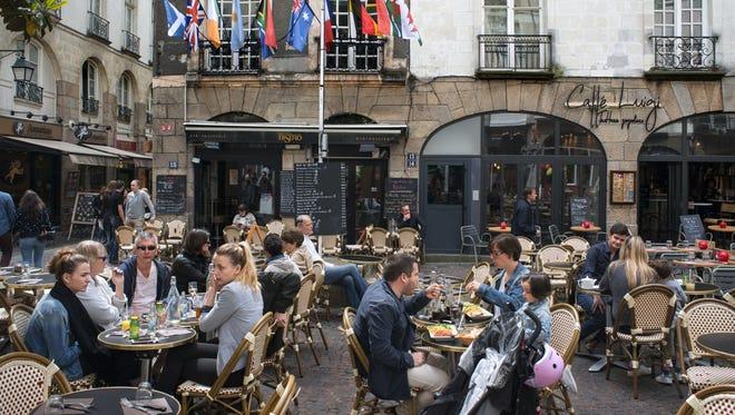 Bars and restaurants atmosphere in old city town of Nantes, Loire Atlantique, France. Caffe Luigi, Place du Pilori.