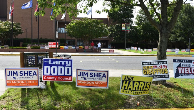 During the June 26 primary elections, Jack Hughes (right) and Dale Murphy stood outside the polling place at the Wicomico Civic Center.