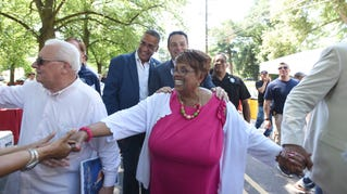 Jane Williams-Warren greeting people after arriving at the surprise party thrown in her honor on her final day as Paterson's mayor, Saturday, June 30, 2018.