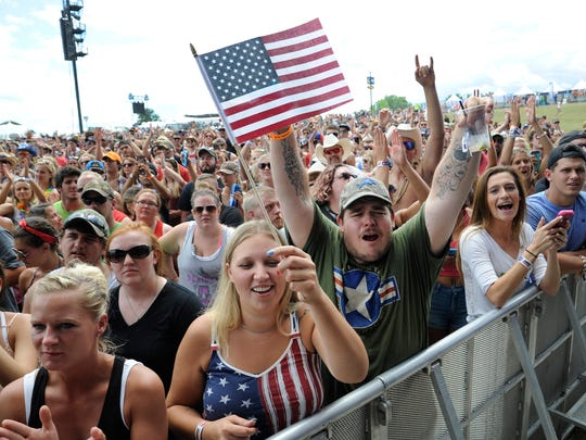 Fans cheer during the LoCash concert at Faster Horses.