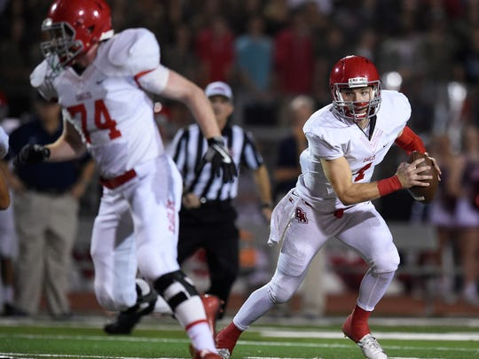 Brentwood Academy QB Jeremiah Oatsvall (4) scrambles against MBA  on Friday, October 7, 2016. The two teams meet again Thursday in the Division II-AA championship game.