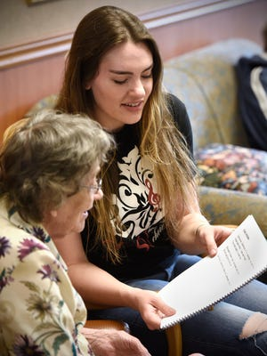 St. Cloud State University Women's Choir member Carly Udelhoven sings April 15, 2016, with a Good Shepherd Community resident. Students have been singing with memory care unit residents each week in preparation for the upcoming Her Story, Her Song concert.