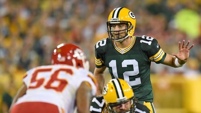 Green Bay Packers quarterback Aaron Rodgers (12) calls signals at the line of scrimmage against the Kansas City Chiefs at Lambeau Field.