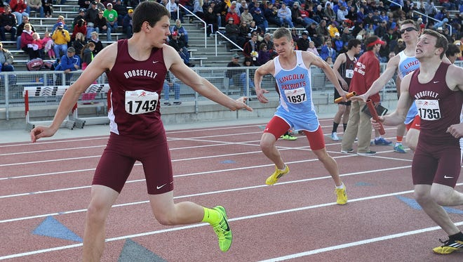 Roosevelt's Josh Goehring waits for a handoff from teammate Daniel Armstrong in the Boys Class AA 4x800 meter relay during Howard Wood Dakota Relays in Sioux Falls, S.D., Friday May 2, 2014.