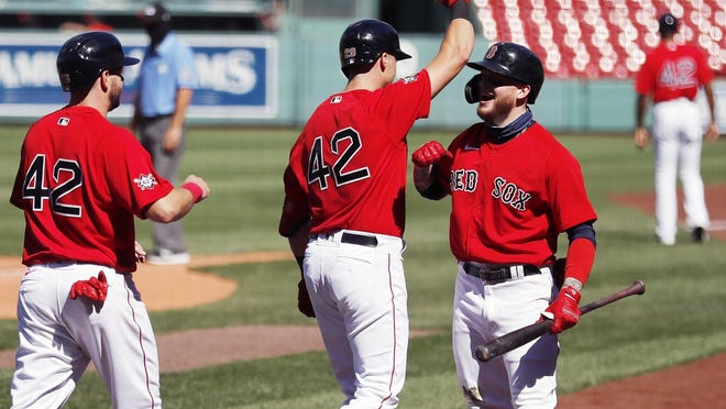 Bobby Dalbec celebrates his first career home run with Alex Verdugo, right, Sunday at Fenway Park. [AP / Michael Dwyer