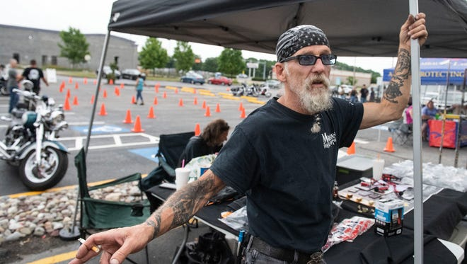 Nick 'Morgan' Adams, of York City, speaks his opinion on Harley-Davidson's business decision to move some production overseas, at a bike night at Quaker Steak and Lube on Wednesday. Harley-Davidson's recent business decision has sparked reaction from President Trump over Twitter. Trump tweeted, 'We won't forget...""