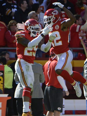 Eric Berry (29) celebrates his second-half interception with Marcus Peters (22).