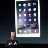 Apple CEO Tim Cook introduces the new Apple iPad Air 2 during an event Thursday at Apple headquarters in Cupertino, Calif.