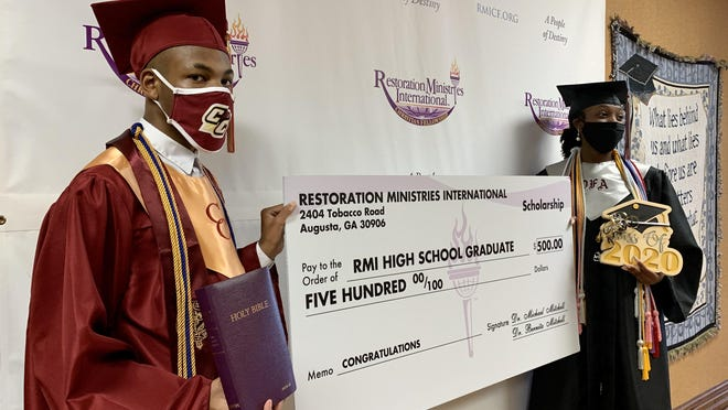 Graduating seniors Mikiyah Lee of Cross Creek High School, left, and Celeste Corbitt of Davidson Fine Arts Magnet School, right, were among several graduates from Restoration Ministries International in Augusta who were honored with scholarships and other gifts for their hard work Sunday, Aug. 2.