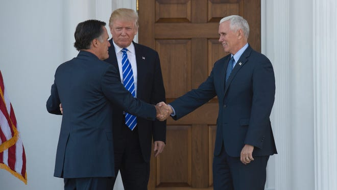 President-elect Donald Trump and vice president-elect Mike Pence welcome Mitt Romney as he arrives for a day of meetings at the clubhouse of Trump National Golf Club Nov. 19, 2016 in Bedminster, N.J.