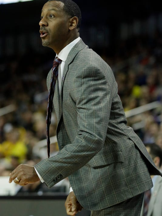 Montana head coach Travis DeCuire directs his team during the first half of an NCAA men's college basketball tournament first-round game against Michigan, Thursday, March 15, 2018, in Wichita, Kan. (AP Photo/Orlin Wagner)