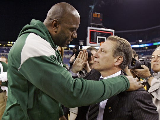 Former Michigan State star Magic Johnson, left, congratulates coach Tom Izzo after Michigan State defeated Louisville 64-52 in the NCAA Midwest Regional men's college basketball tournament final Sunday, March 29, 2009, in Indianapolis. Michigan State advances to the Final Four in Detroit.