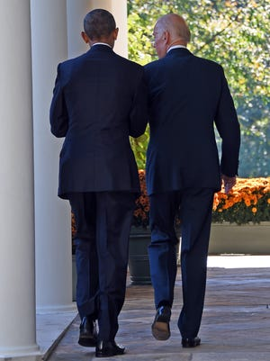 Vice President Biden leaves with President Obama after speaking in the Rose Garden at the White House Wednesday. Biden announced that he is not running for president.