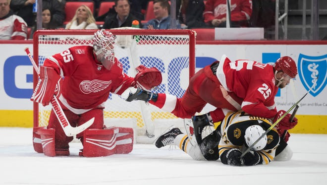 Red Wings defenseman Mike Green (25) and goalie Jimmy Howard, left, are among the names that could possibly pop up on the trade market.
