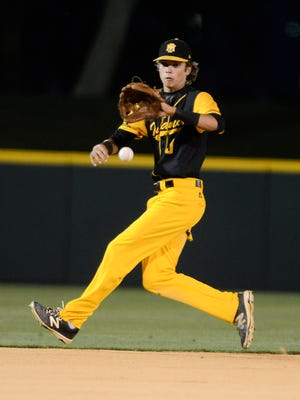 Merritt Island SS Brady McConnell fields a grounder during the 2016 district championship game against Rockledge.