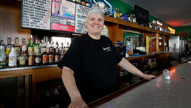 Becky Stamatkin behind the bar at Workingman's Friend Friday, Jan. 19, 2018