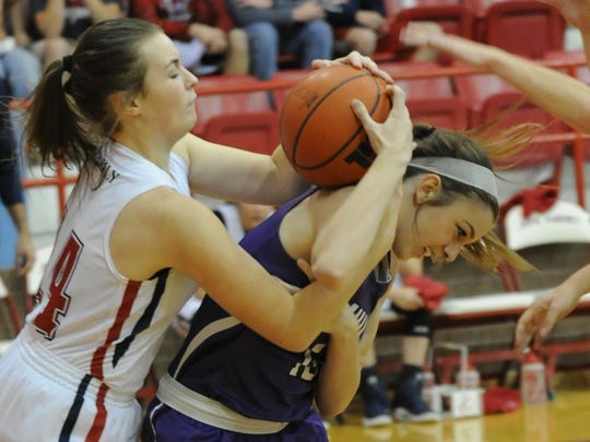 Wylie's Claire Allen, right, battles Jim Ned's Jenna Moore for the ball. Wylie beat the Lady Indians 47-40 in the nondistrict game Monday, Dec. 19, 2016 at Bill Thornton Arena in Tuscola.