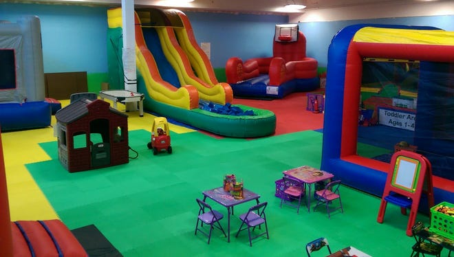 The play area at Bounce House on Davis Highway features lots of fun activities for kids, including a number of inflatables.