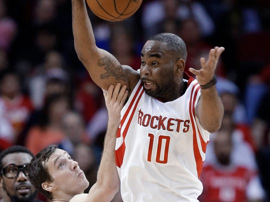 Houston Rockets guard Marcus Thornton (10) grabs a