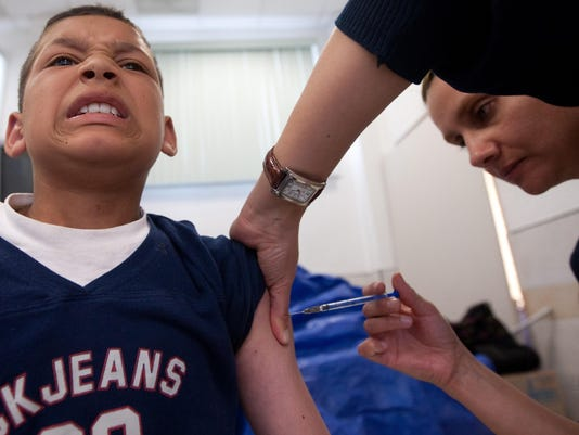 A boy is vaccinated during a day of the