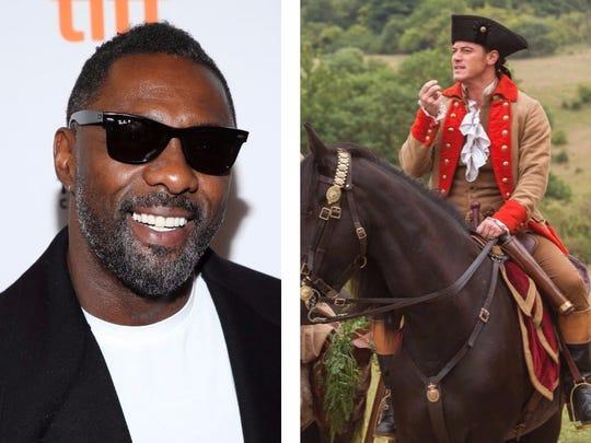 Idris Elba (left) and Luke Evans as Gaston