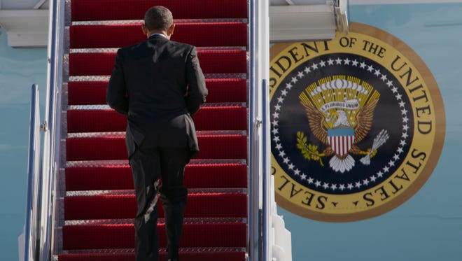 President Obama boards Air Force One.