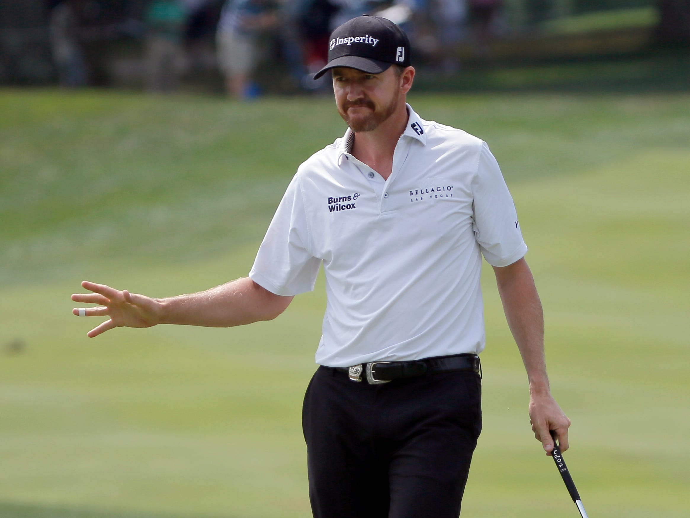 Jimmy Walker reacts to his putt on the third hole during the first round of the PGA Championship golf tournament at Baltusrol Golf Club in Springfield, N.J.