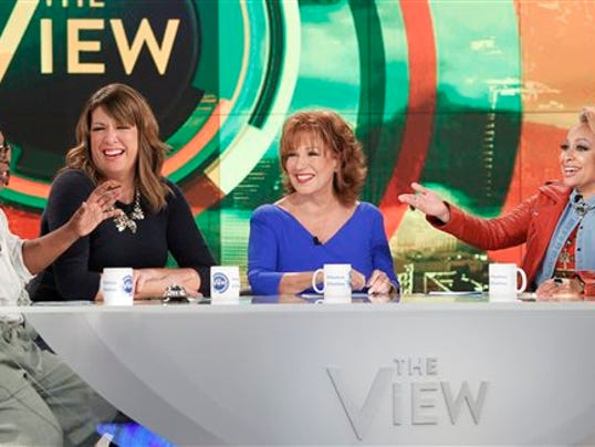 "In this Sept. 9, 2015 photo released by ABC, co-hosts, from left, Whoopi Goldberg, Michelle Collins, Joy Behar and Raven-Symone appear on the daytime talk show, ""The View,"" in New York."