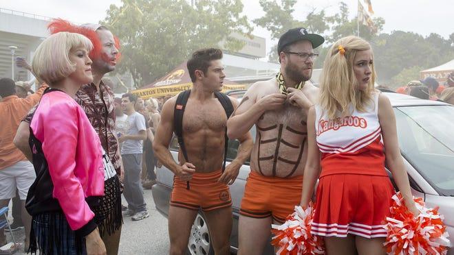 "Carla Gallo, Ike Barinholtz, Zac Efron, Seth Rogen and Rose Byrne in ""Neighbors 2: Sorority Rising."""