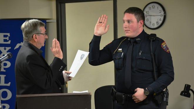 Algoma Mayor Wayne Schmidt swears in Officer Cody Gulbrand to the Algoma Police Department.