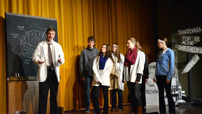 Daniel Mansur rehearses as Frederick Frankenstein with members of the Algoma High School musical program on Dec. 30.