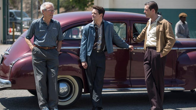 """This photo released by Warner Bros. shows director/producer, Clint Eastwood, from left, Vincent Piazza and Michael Lomenda on the set of Warner Bros. Pictures' musical """"Jersey Boys,"""" a Warner Bros. Pictures release. (AP Photo/Warner Bros. Pictures, Keith Bernstein)"""