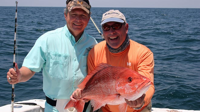 Conservation Commissioner N. Gunter Guy Jr. and Conservation Advisory Board member Joey Dobbs show off a nice snapper.