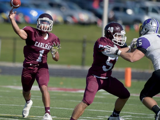 Earlham's Wesley Hundley throws the ball against Bluffton Saturday, Nov. 5, 2016 during a football game at Earlham College in Richmond.