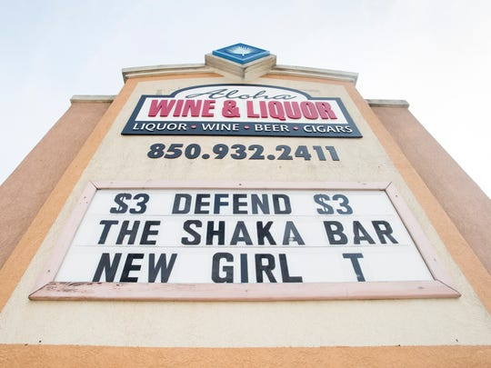 On a sign outside the bar, the Shaka Bar has often made tongue-in-cheek references to the lawsuit filed against the bar by the Sandshaker Lounge.