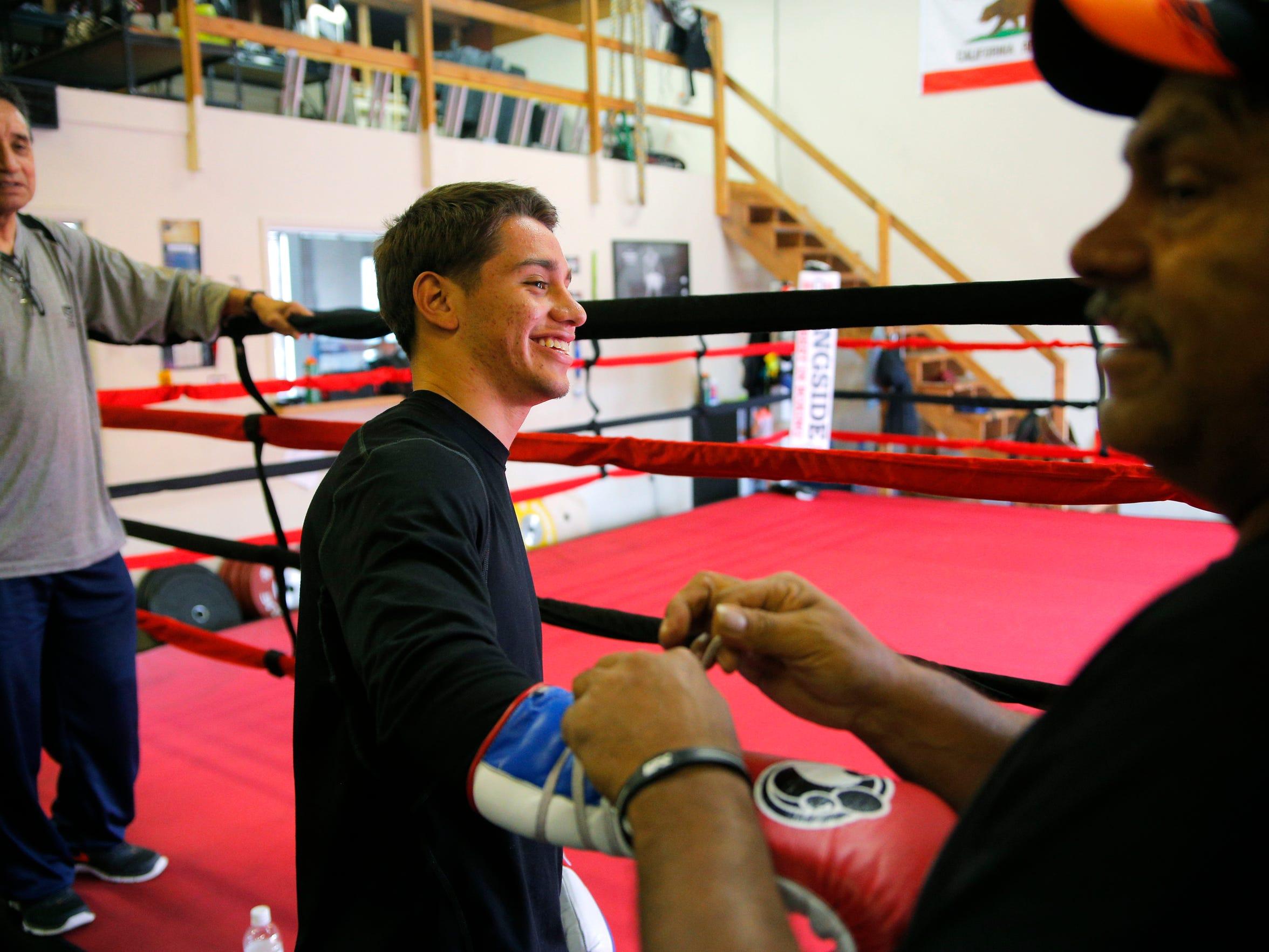 Ruben Villa of Salinas has his boxing gloves tied by