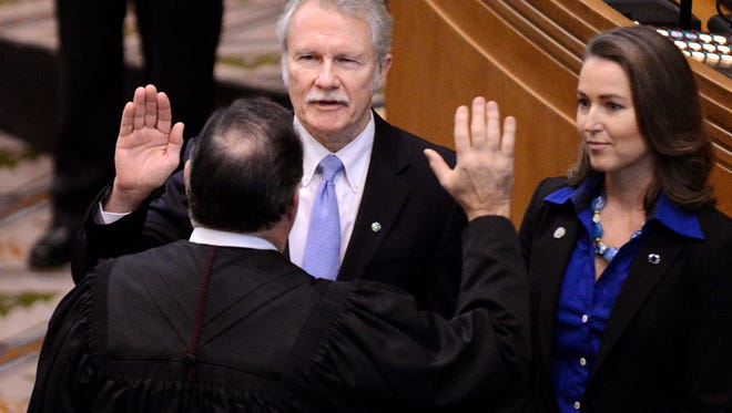 Oregon Gov. John A. Kitzhaber is sworn in to his historic fourth term as his fiancée Cylvia Hayes looks on during the first day of the 2015 Oregon Legislature at the state Capitol building on Monday, January 12, 2015, in Salem.